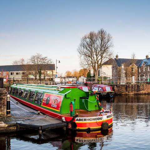 Brecon canal with colourful canal boats in the foreground